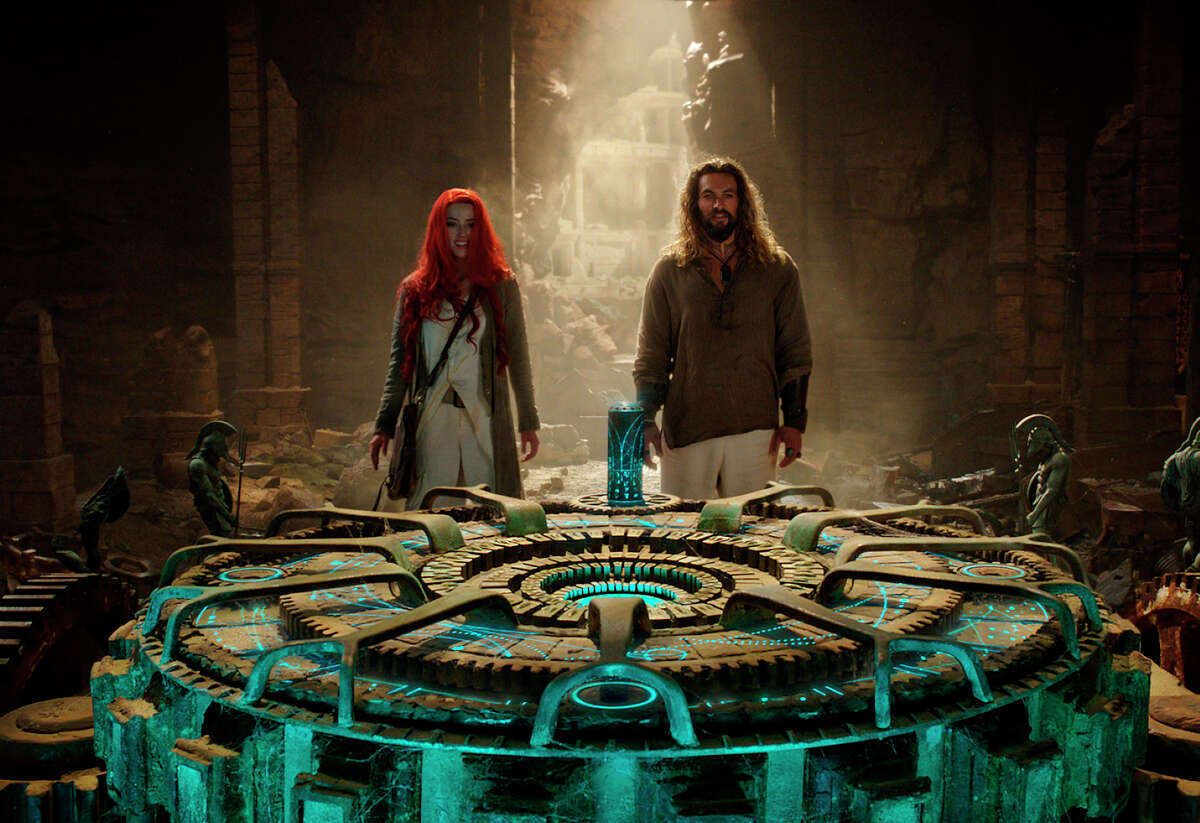 This image released by Warner Bros. Pictures shows Amber Heard, left, and Jason Momoa in a scene from