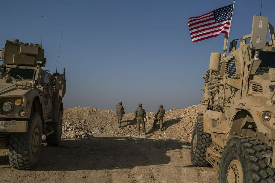 U.S. Special Forces patrol near Manbij, in northern Syria. President Trump has ordered a rapid withdrawal of all 2,000 U.S. ground troops within 30 days. Photo: Mauricio Lima / New York Times