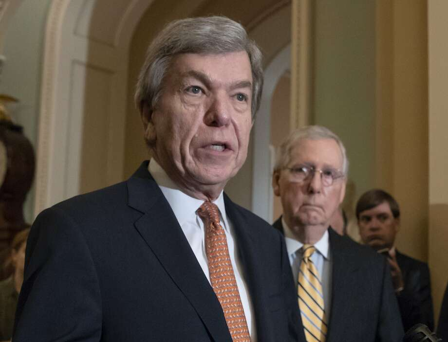 FILE - In this Aug. 21, 2018, file photo, Sen. Roy Blunt, R-Mo., speaks as Senate Majority Leader Mitch McConnell, R-Ky., listens at the Capitol in Washington. House and Senate negotiators have reached an agreement on a bill to overhaul the process for handling sexual misconduct allegations on Capitol Hill. The push for the legislation took on new urgency in the past year, as more than a half-dozen lawmakers resigned amid allegations of sexual misconduct. (AP Photo/J. Scott Applewhite, File) Photo: J. Scott Applewhite / Associated Press