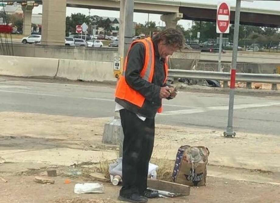 A popular San Antonio newspaper hawker, known for his cheerful attitude while selling newspapers near Loop 1604 and U.S. 281 on Sundays, was shocked when loyal buyers gifted him $1,500 in cash Sunday. Photo: Courtesy Of Pierce Caldwell