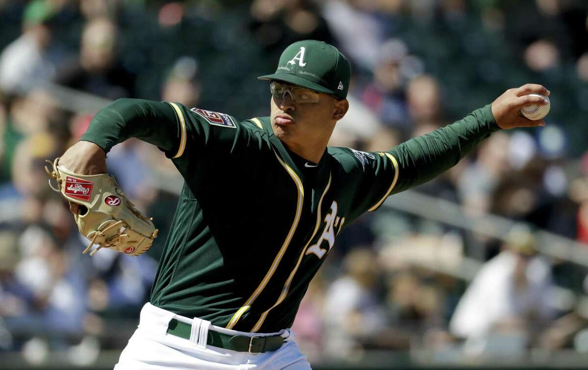 Jesus Luzardo throws against the Chicago White Sox during the third inning of a spring baseball game in Mesa, Ariz., Sunday, March 18, 2018. (AP Photo/Chris Carlson)