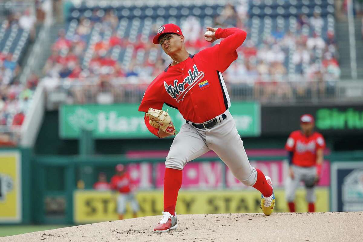 WASHINGTON, DC - JULY 15: Starting pitcher Jesus Luzardo #9 of the Oakland Athletics and the World Team works the first inning against the U.S. Team during the SiriusXM All-Star Futures Game at Nationals Park on July 15, 2018 in Washington, DC. (Photo by Patrick McDermott/Getty Images)