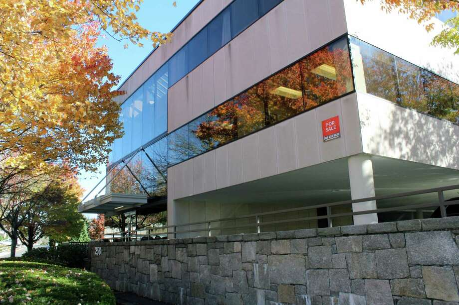 Minerals and materials firm Covia plans to close its offices at 258 Elm St. in New Canaan in 2020, cutting about 60 local jobs. Photo: Hearst Connecticut Media File Photo / New Canaan News