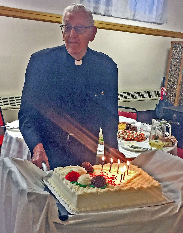 Monsignor Thaddeus Malanowski of Holy Name of Jesus Church at his recent 96th birthday party.