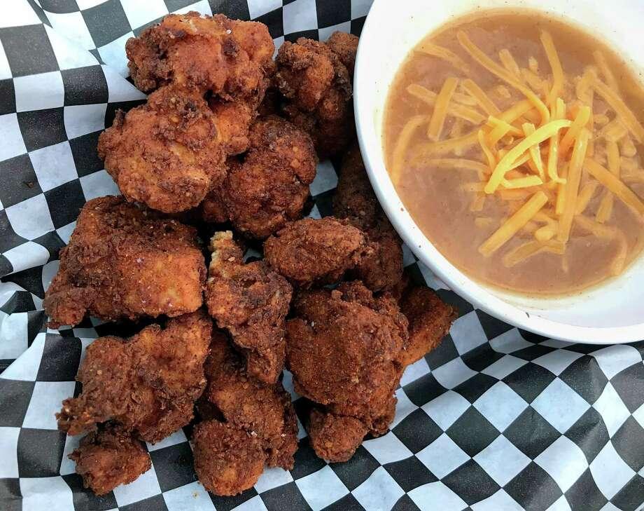 San Antonio Hot Chicken Thigh Nuggets with Enchilada Gravy from Shuck Shack. Photo: Paul Stephen / Staff