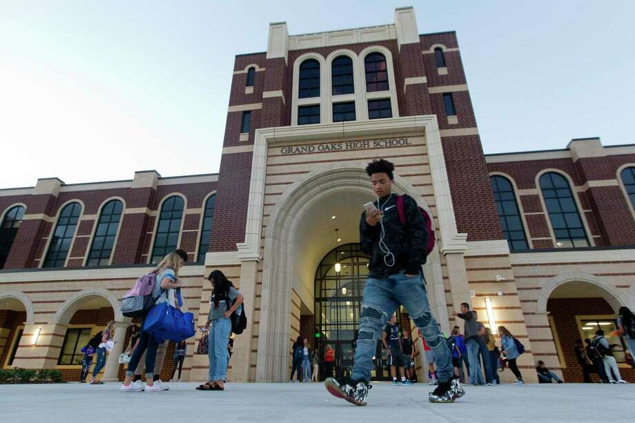 Just four years after the current bond referendum is nearing completion, the Conroe Independent School District is discussing the next potential bond—that may come with a higher price tag. In this file photo, Grand Oaks High School students wait outside on the first day of school on Wednesday, Aug. 15, 2018, in Spring. Photo: Jason Fochtman, Staff Photographer / Staff Photographer / © 2018 Houston Chronicle