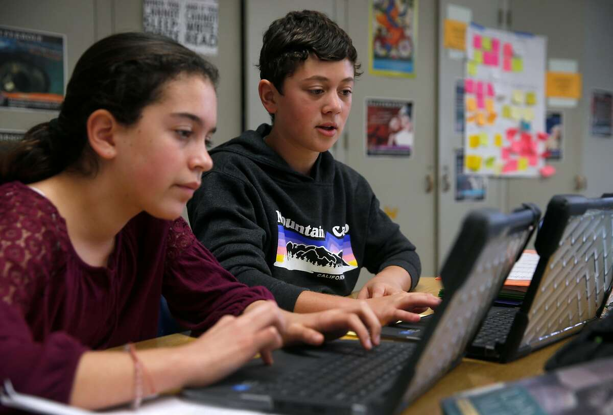 Seventh grader Max Dreskin (right) works on a project about ancient religions with Ellie Broscow in their Humanities class at Prospect Sierra Middle School in El Cerrito, Calif. on Wednesday, Dec. 19, 2018. Rather than buying something for himself, Dreskin donated more than $150 he received for his birthday to an organization which feeds homeless mothers and their children.