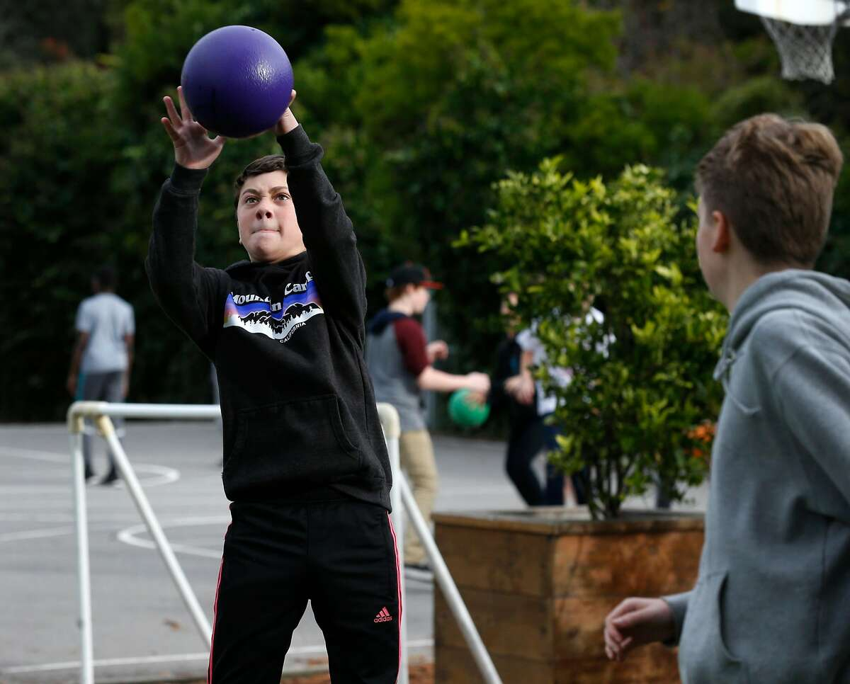 Seventh grader Max Dreskin plays ball with schoolmates during a recess at Prospect Sierra Middle School in El Cerrito, Calif. on Wednesday, Dec. 19, 2018. Rather than buying something for himself, Dreskin donated more than $150 he received for his birthday to an organization which feeds homeless mothers and their children.