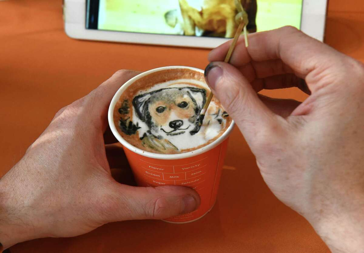 World-renowned latte artist Michael Breach surprises guests with personalized latte art at the Dunkin?• restaurant at Colonie Center on Wednesday, Dec. 19, 2018 in Colonie, N.Y. The restaurant was celebrating their new espresso drinks. (Lori Van Buren/Times Union)