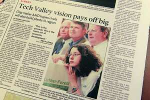 A June 24, 2006 poster of the front page of the Schenectady Gazette shows Jenney Kelley, foreground, with her father, Jack Kelley, at the announcement that AMD was coming to Luther Forest to build their chip plant. Jenney Kelley is now working as an economic development assistant with Saratoga County Prosperity Partnership. Her father is director of economic development at Prime Companies.   (Paul Buckowski/Times Union)