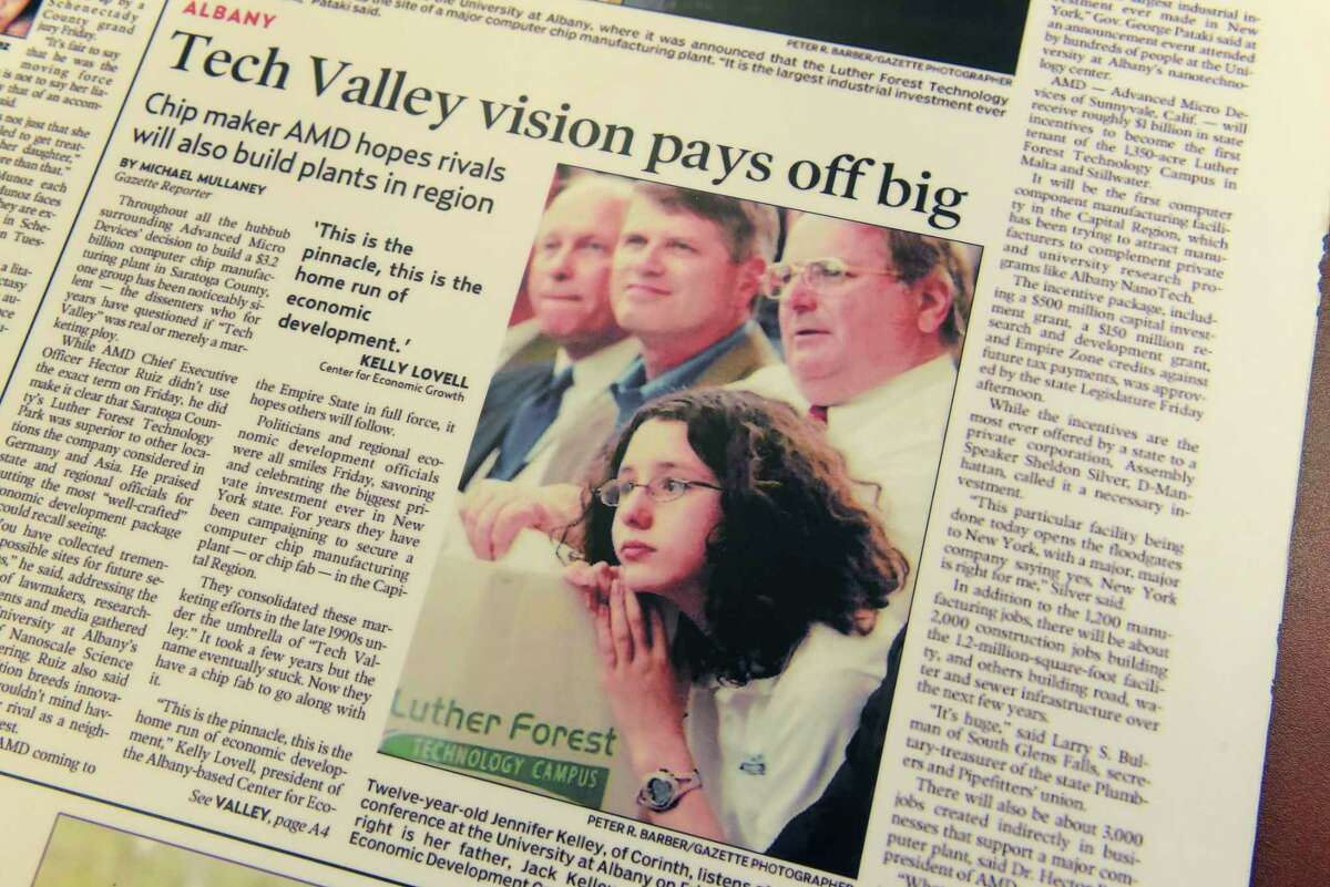 A June 24, 2006 poster of the front page of the Schenectady Daily Gazette shows Jenney Kelley, foreground, with her father, Jack Kelley, at the announcement that AMD was coming to Luther Forest to build their chip plant. AMD later spun off its factories into GlobalFoundries.(Paul Buckowski/Times Union)
