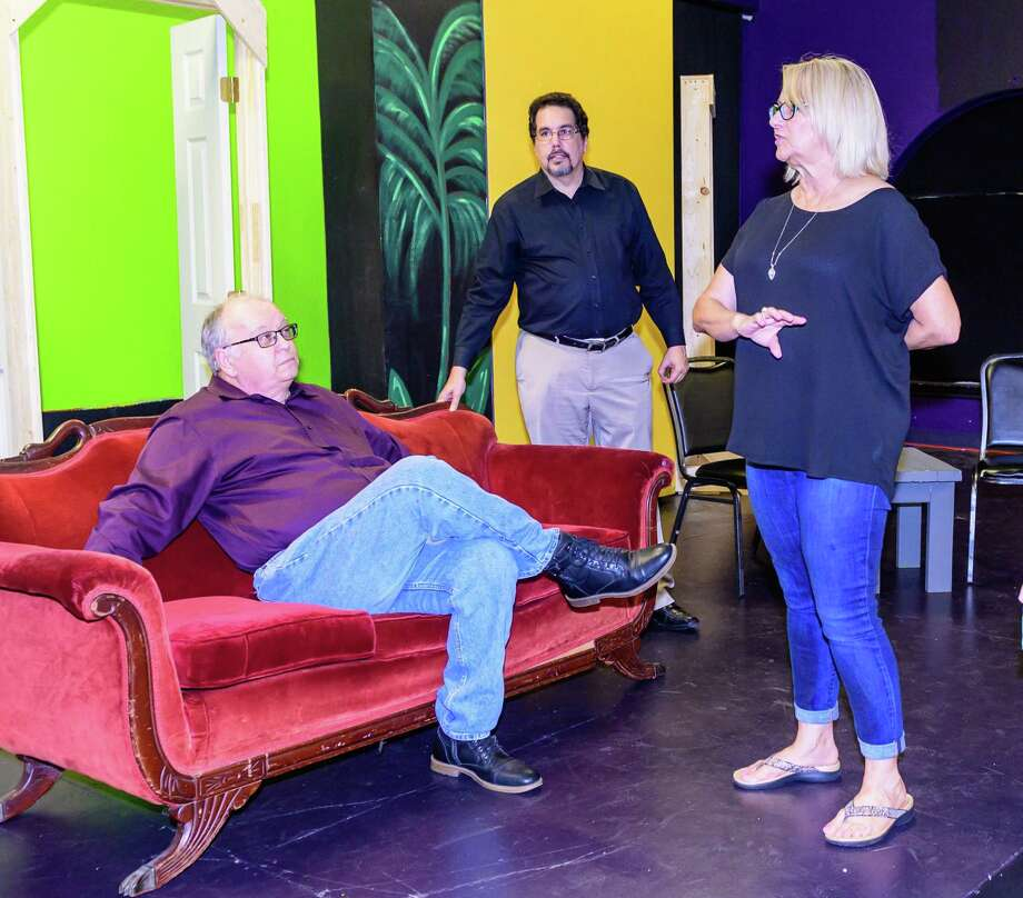 "Cathy Holbrook, shown directing actors in Purple Box Theater's ""The Haunting of Hill House"" this fall, has been nominated in numerous categories in the 2018 Broadway World Houston Awards. On Dec. 17, the entertainment site announced that, midway through voting, two of the top five vote-getters for best play were ""Haunting"" and another Holbrook-directed production, ""Cat on a Hot Tin Roof."" Holbrook received individual nominations, including nods for lighting and set design. Photo: ©Kim Christensen, Photographer / ©Kim Christensen / ©Kim Christensen"
