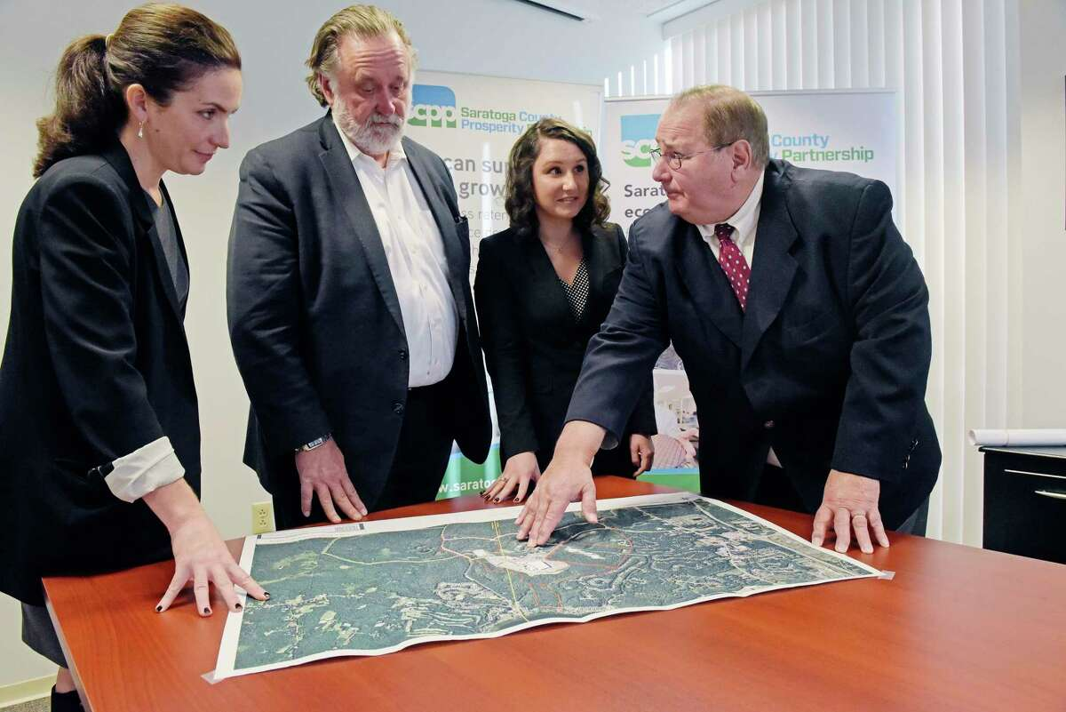 From left, Shelby Schneider, president of Saratoga County Prosperity Partnership, stands with Marty Vanags, past president of the Partnership and Jenney Kelley, an economic development assistant with Prosperity Partnership, and Jack Kelley, director of economic development at Prime Companies, on Wednesday, Dec. 19, 2018, in Malta, N.Y. (Paul Buckowski/Times Union)