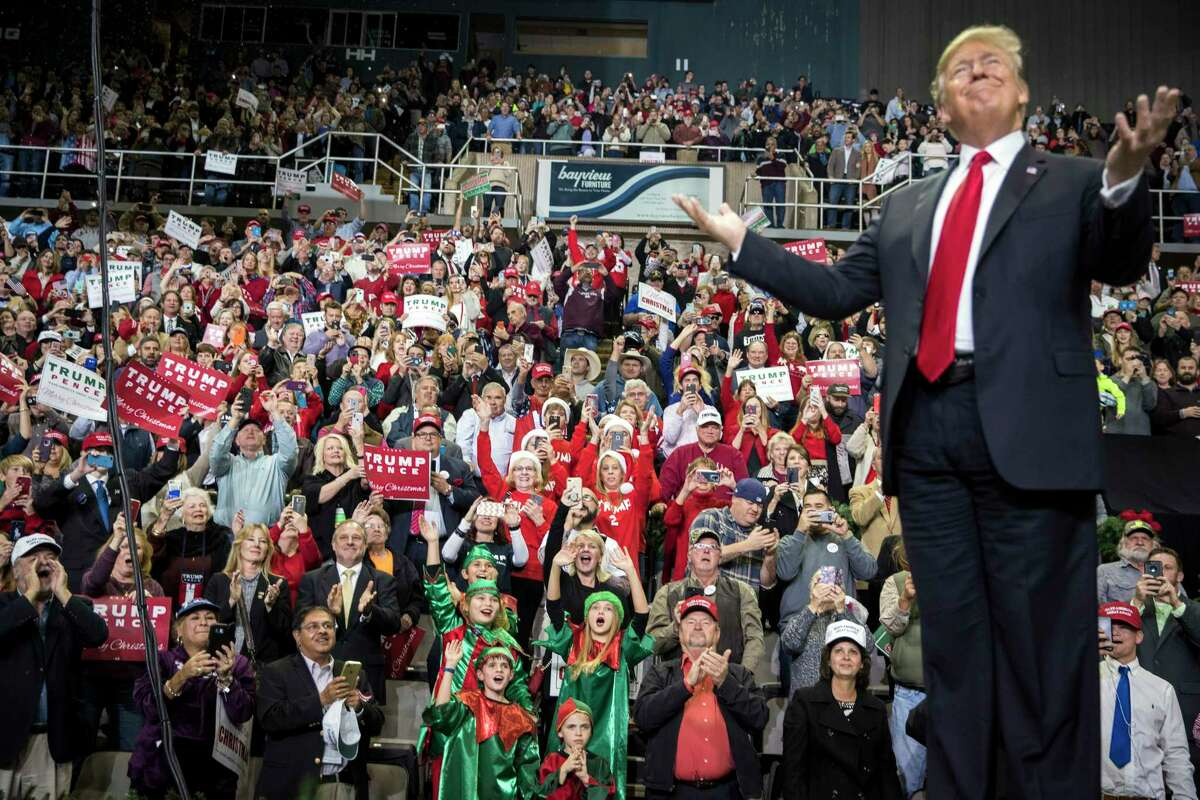 President Donald Trump takes the stage at a rally in Biloxi, Miss., on Nov. 26, 2018. The president routinely makes claims of his superiority as president, and his first re-election ad is no different. >>Here's what Politifact found about many of those claims...
