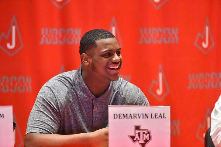 Judson's DeMarvin Leal smiles during college signing day at Judson High School Monday morning. Leal signed with Texas A&M.