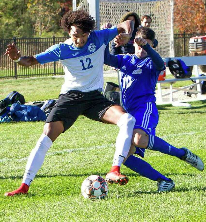 Reshaun Walkes of Lewis and Clark (12) has been named to the NJCAA Men's All-America Soccer Team. Above battles for the ball with Illinois Central's Federico Zanna during action in the Region 24 Tournament championship game at LCCC. Photo: File Photo