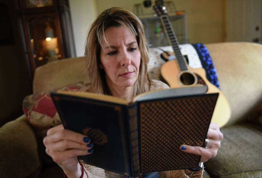 Kim Wickham reads one of her journals at her home on Friday, Dec. 14, 2018 in Glenmont, N.Y. Wickham was a Syracuse University student studying in London in fall 1988 and had a flight home on Pan Am flight 103 on Dec. 21 but decided to stay abroad for the holidays. Many of her friends died when the flight was destroyed by a bomb over Lockerbie, Scotland. (Lori Van Buren/Times Union)