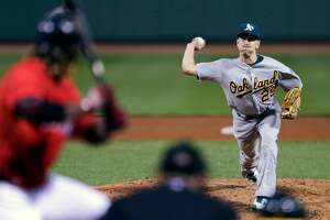 Oakland Athletics ambidextrous relief pitcher Pat Venditte (29) delivers to Boston Red Sox's Hanley Ramirez in the seventh inning during a baseball game at Fenway Park in Boston, Friday, June 5, 2015. (AP Photo/Charles Krupa)