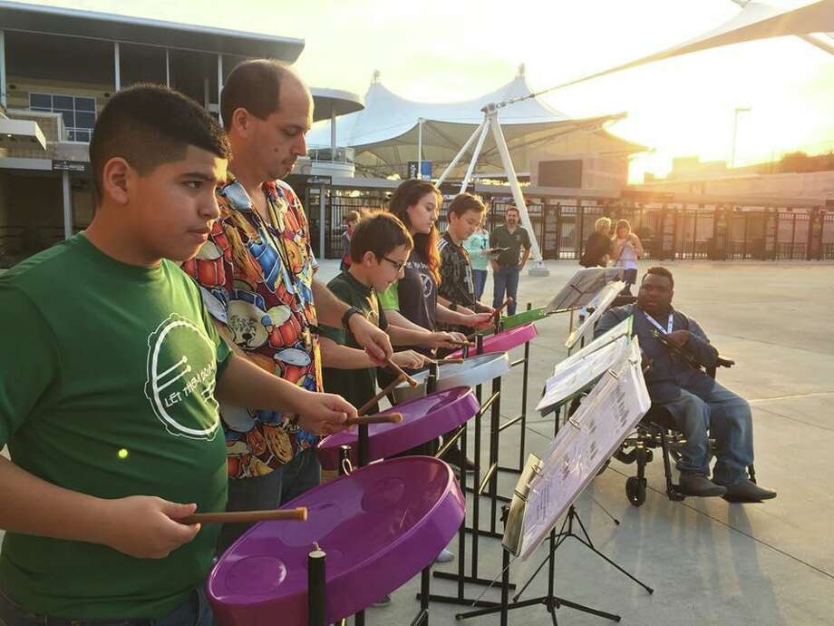 The Journey School has partnered with Let Them Drum, a nonprofit run by Ralph Hicks that is a weekly gathering of both special needs and typical children who want to drum: whether it's on hand drums or steel drums. The drumming acts as physical therapy for many kids with special needs. In these file photos, members of the organization are shown performing. Photo: Courtesy Photos / Courtesy Photos