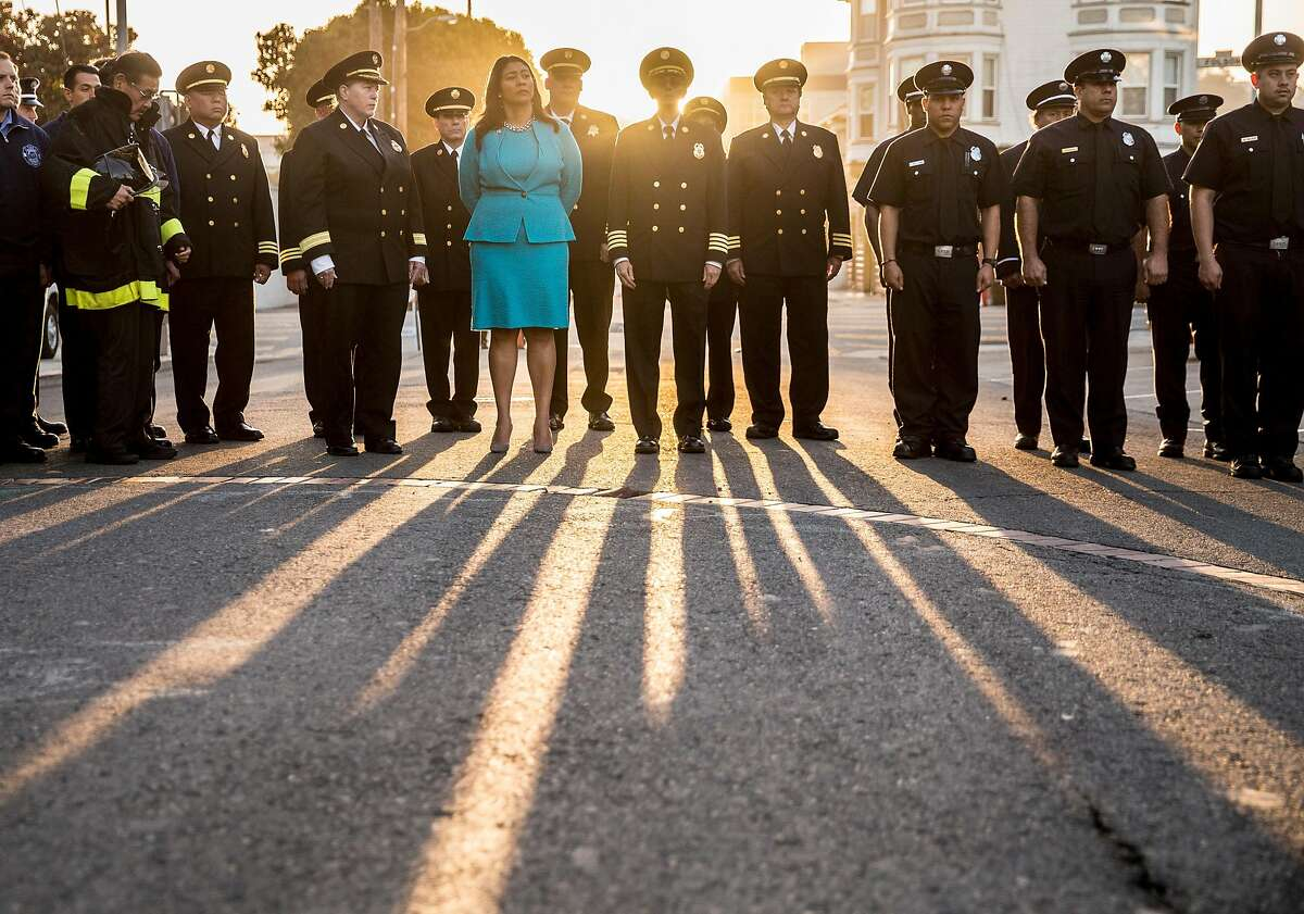 Mayor London Breed, center, and San Francisco Fire Chief Joanna Hayes-White, third left, join members of the San Francisco Fire Department at San Francisco Fire Station 7 in the Mission district of San Francisco, Calif. Tuesday, Sept. 11, 2018 to read the names of the victims of the September 11 terrorist attack that occurred 17 years ago in New York City.