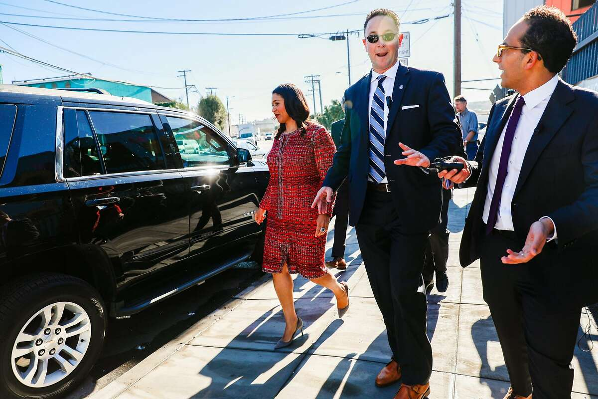 Mayor London Breed walks back to her car after taking a tour of the Bayshore Navigation Center in San Francisco, California, on Wednesday, Nov. 7, 2018.