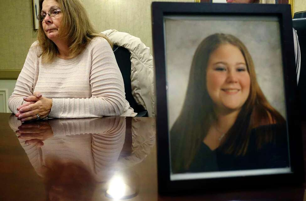 Donna Rivenburg, the mother of Amanda Rivenburg, foreground photo, talks about her daughter during an interview at the Girvin & Ferlazzo law firm on Tuesday, Dec. 18, 2018, in Albany, N.Y. Amanda was killed in the Schoharie limo crash. (Paul Buckowski/Times Union)