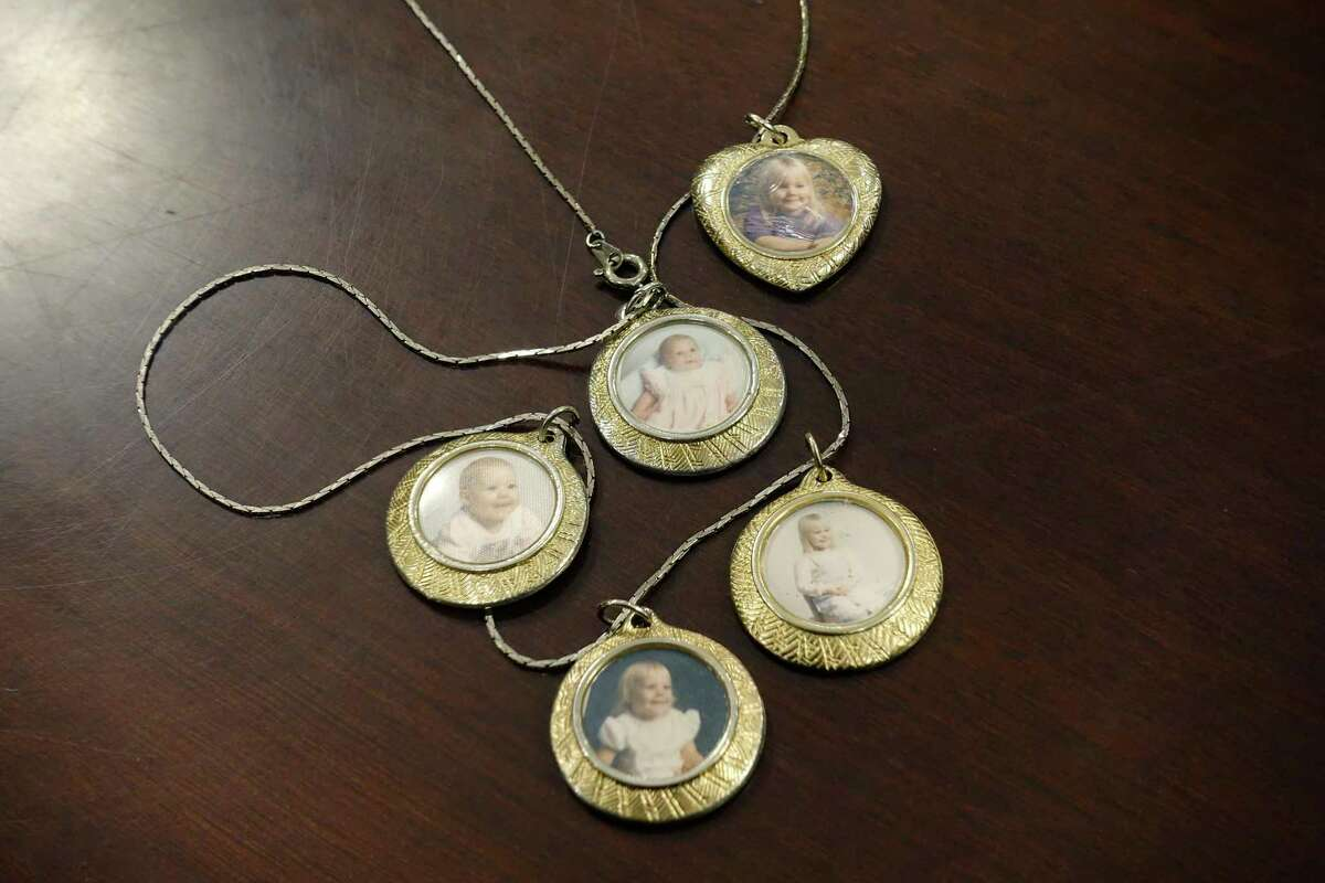 A view of a necklace that Donna Rivenburg wears is seen at the Girvin & Ferlazzo law firm on Tuesday, Dec. 18, 2018, in Albany, N.Y. The photos on the necklace are of her daughter, Amanda Rivenburg, when she was younger. Amanda was killed in the Schoharie limo crash. (Paul Buckowski/Times Union)