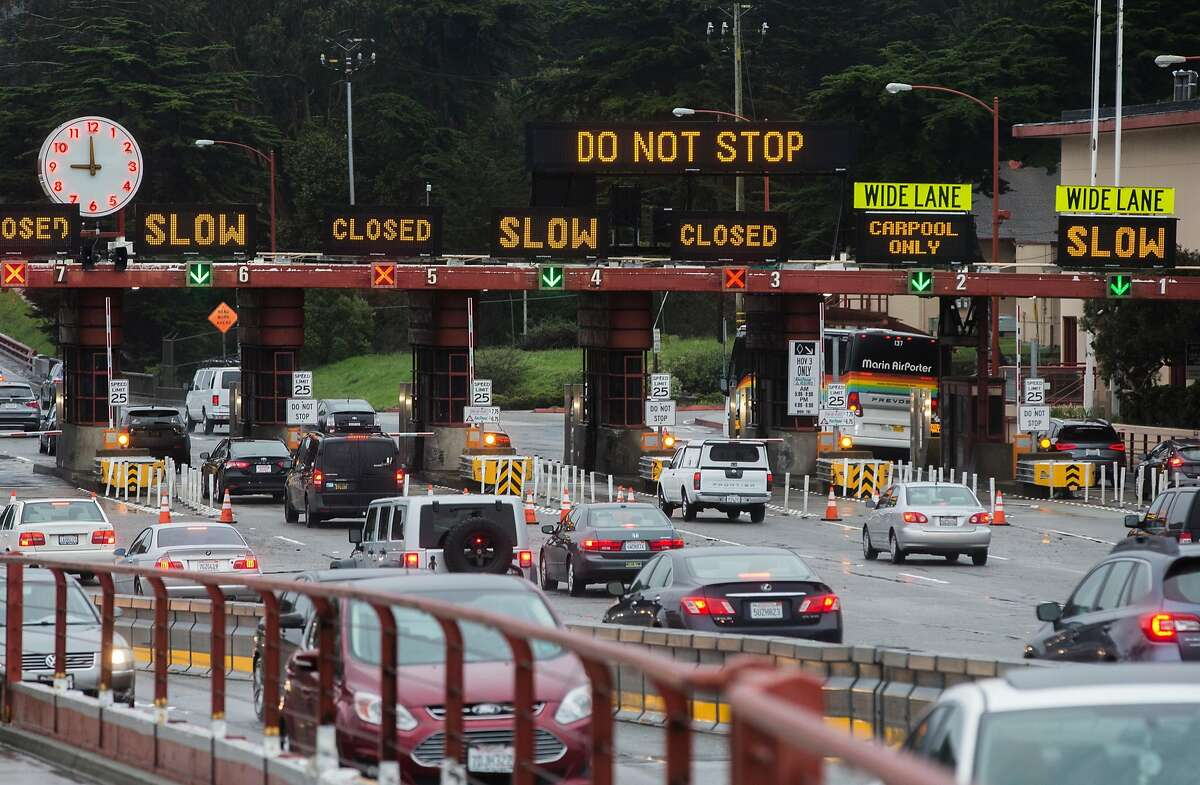 Traffic builds up as cars enter the Golden Gate Bridge Toll Plaza during a raingy morning commute Thursday, March 22, 2018 in San Francisco, Calif.