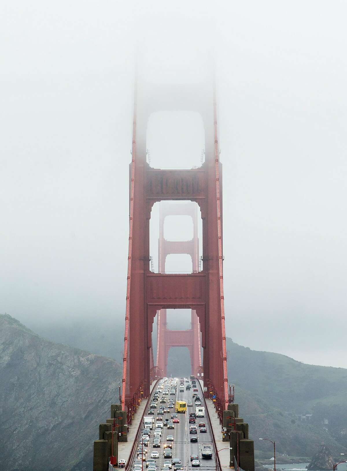 Cars drive over the Golden Gate Bridge during a rainy morning commute Thursday, March 22, 2018 in San Francisco, Calif.