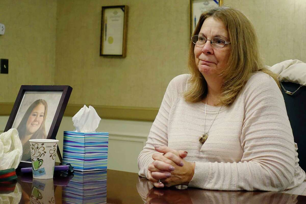 Donna Rivenburg, the mother of Amanda Rivenburg, talks about her daughter during an interview at the Girvin & Ferlazzo law firm on Tuesday, Dec. 18, 2018, in Albany, N.Y. Amanda was killed in the Schoharie limo crash. The photo in the frame on the left is of Amanda. (Paul Buckowski/Times Union)
