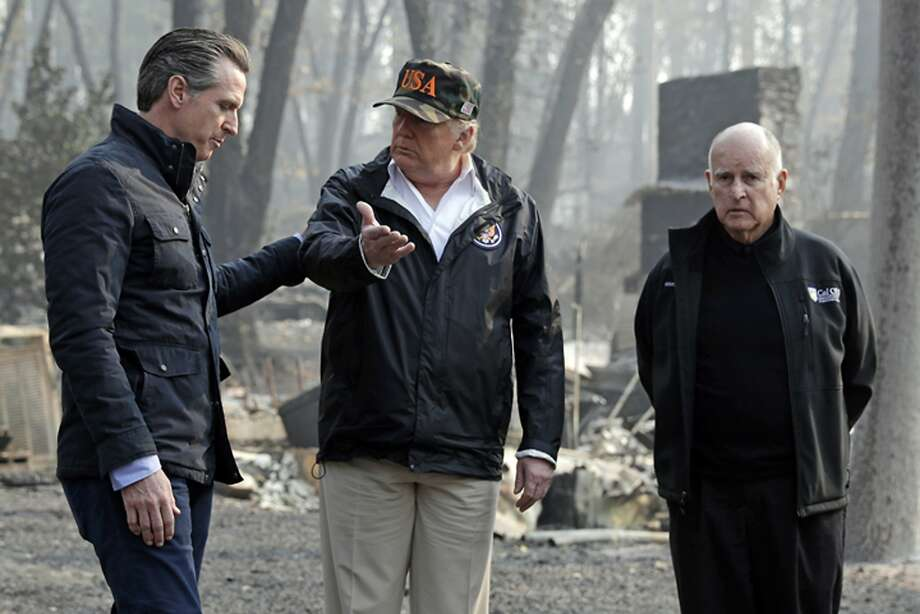 FILE - In this Nov. 17, 2018 file photo, President Donald Trump talks with Gov.-elect Gavin Newsom, left, as California Gov. Jerry Brown listens during a visit to a neighborhood impacted by the Camp wildfire in Paradise, Calif. For US governors, including 19 taking office early next year, fires, floods and other climate-related emergencies could become top policy concerns. For some, the concern is often trying to curtail global warming. But other leaders also have taken steps to mitigate damage from future disasters. (AP Photo/Evan Vucci, File) Photo: Evan Vucci / Associated Press