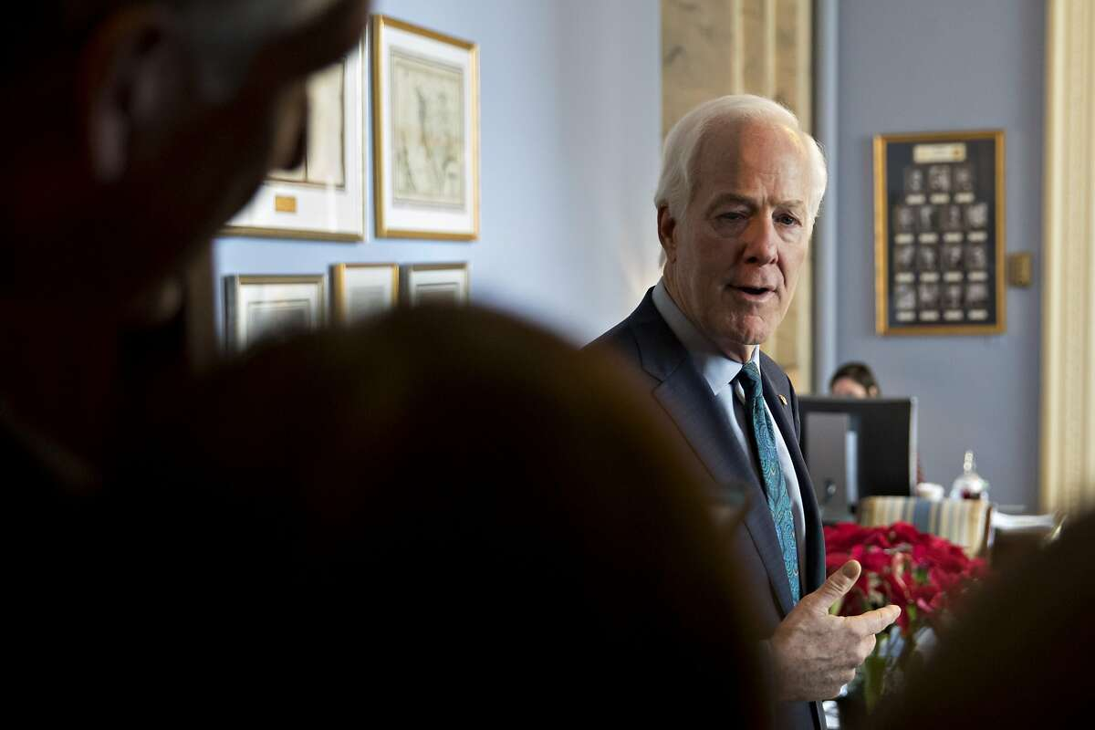 Senate Majority Whip John Cornyn, a Republican from Texas, speaks to members of the media at his office at the U.S. Capitol in Washington, D.C., U.S., on Wednesday, Dec. 19, 2018. Senate Majority Leader Mitch McConnell said he'll introduce a short-term spending bill today to avoid a partial federal shutdown and keep the government funded until Feb. 8. Photographer: Andrew Harrer/Bloomberg