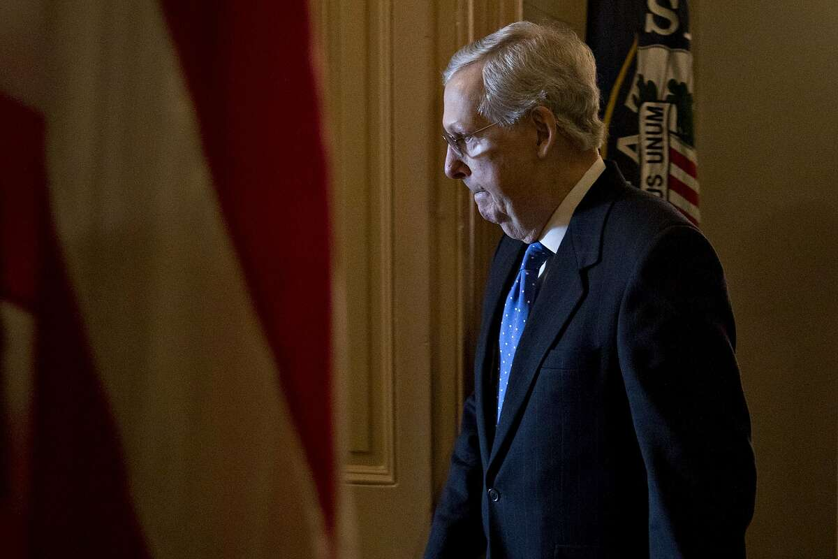 Senate Majority Leader Mitch McConnell, a Republican from Kentucky, walks into his office at the U.S. Capitol in Washington, D.C., U.S., on Wednesday, Dec. 19, 2018. McConnell said he'll introduce a short-term spending bill today to avoid a partial federal shutdown and keep the government funded until Feb. 8. Photographer: Andrew Harrer/Bloomberg