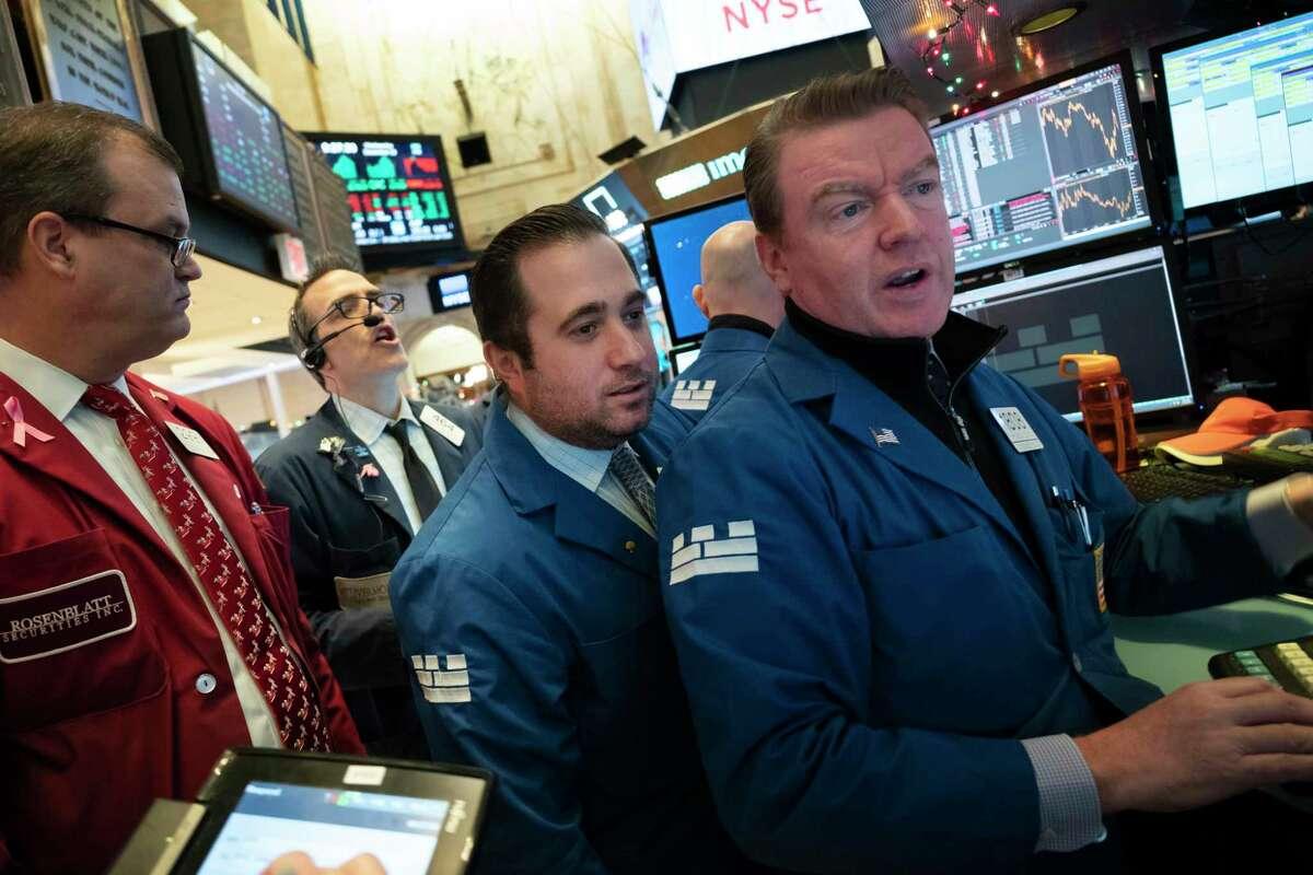 Stock traders work at the New York Stock Exchange, Wednesday, Dec. 19, 2018. (AP Photo/Mark Lennihan)