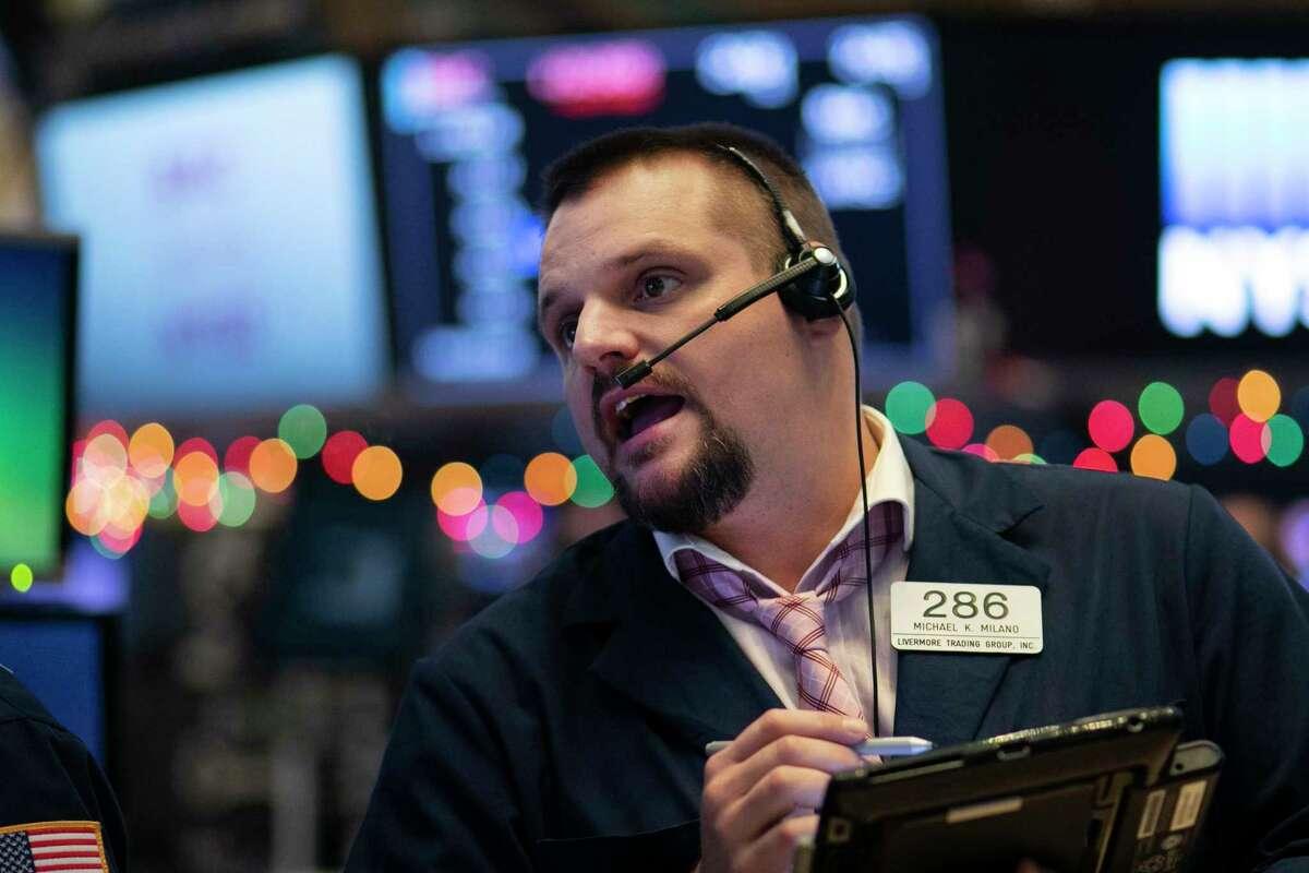 Stock trader Michael Milano works at the New York Stock Exchange, Wednesday, Dec. 19, 2018. (AP Photo/Mark Lennihan)