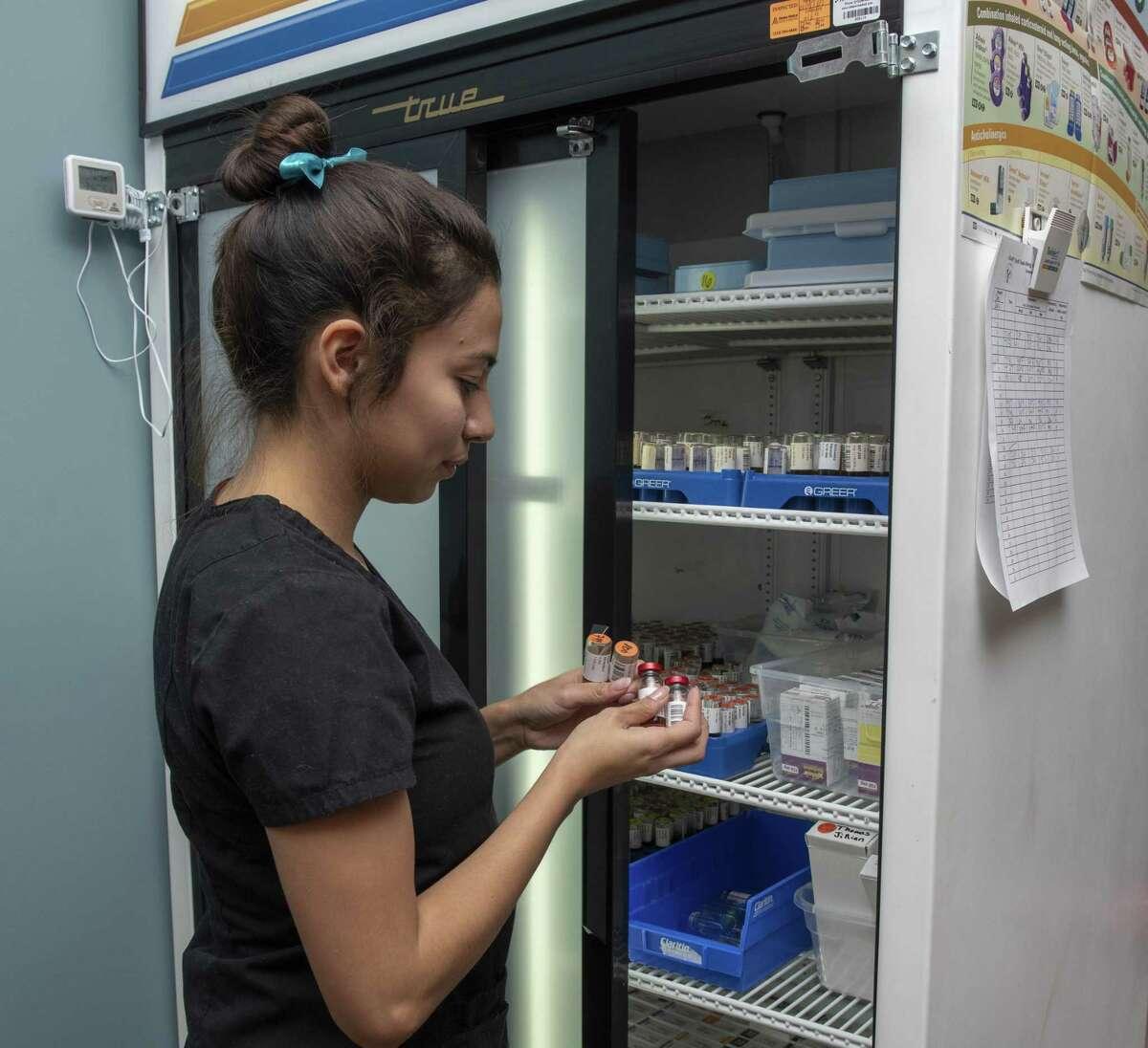 Medical assistant, Dominique Munoz, prepares allergy shots