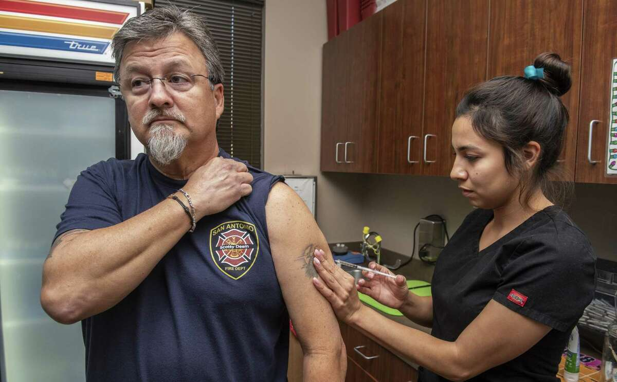 Medical assistant, Dominique Munoz, administers an allergy shot to Edward Puente at the South Texas Allergy and Asthma Medical Professionals office.