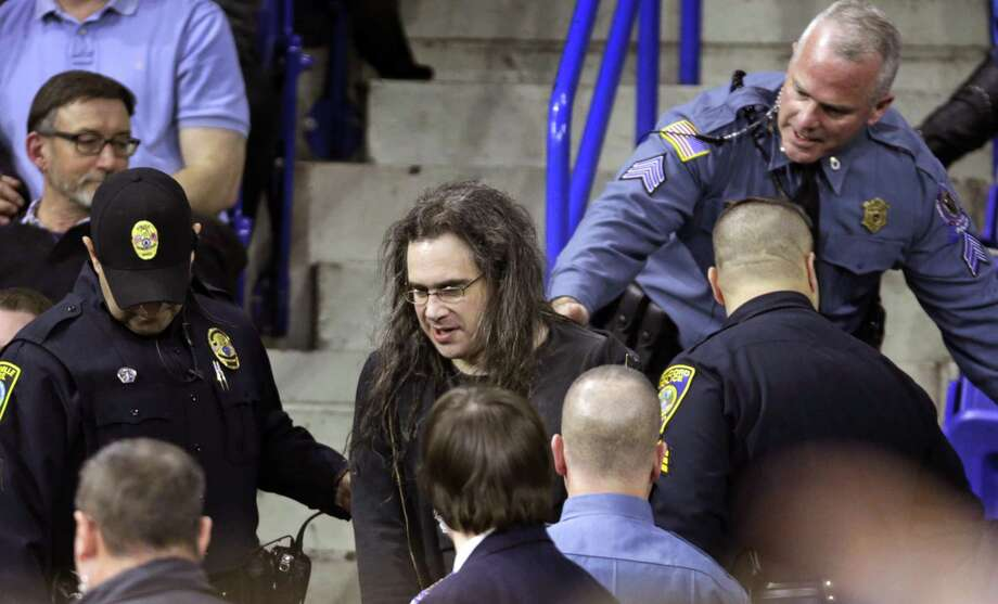 Police remove a protester during an address by then presidential candidate Donald Trump in Lowell, Mass., in 2016. It seems people are unable to express their views without degrading the other side. Photo: Associated Press File Photo / AP