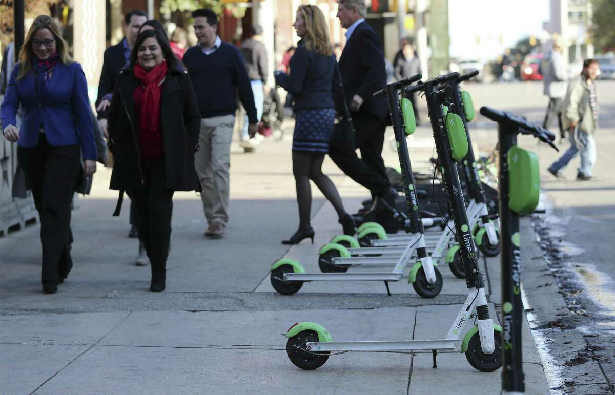 Scooters line a section of Commerce Street on Dec. 4. The city has some interesting technological solutions for irresponsible scooter use and parking.