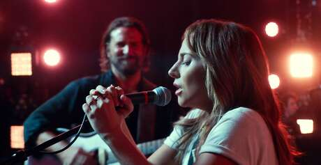 "This image released by Warner Bros. shows Bradley Cooper, left, and Lady Gaga in a scene from the latest reboot of the film, ""A Star is Born."" Surely literal goosebumps are a good sign that you've just seen a pretty stunning movie moment, specifically where Lady Gaga's Ally takes a deep breath and walks out on stage to join Bradley Cooper's Jackson Maine and sing her song in front of thousands of people. (Neal Preston/Warner Bros. via AP) Photo: Associated Press"