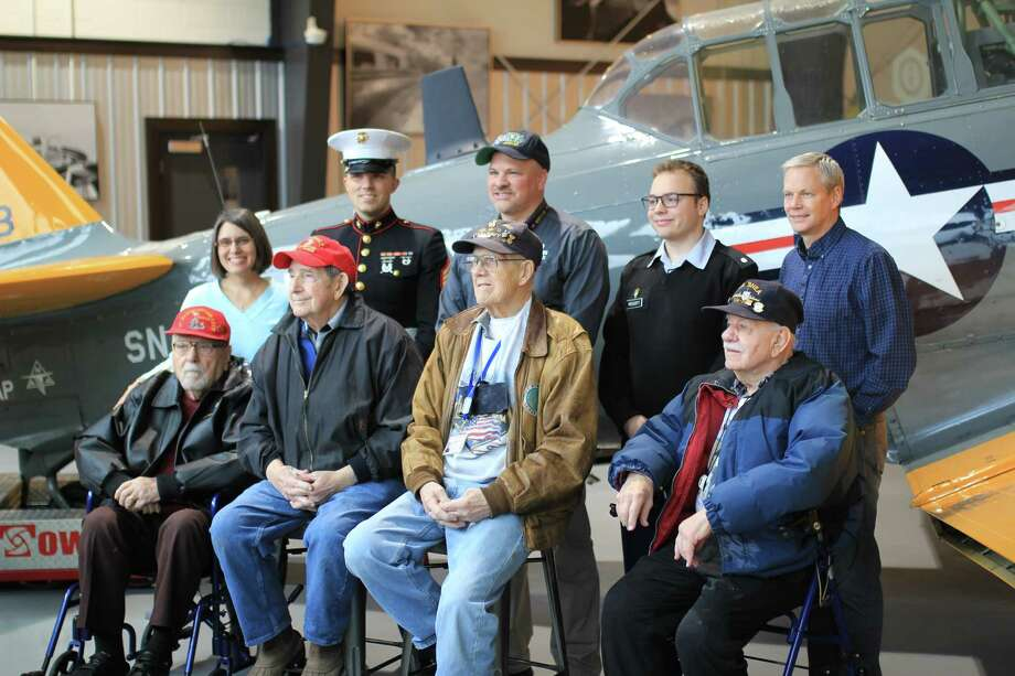 Integra Optics held a veterans' appreciation event recently. Here, World War II veterans, from left, Thomas Smith (Marines), Tom Lemme (Marines), Walter Shults (Navy) and Frank Dashnaw (Navy) pose with Integra Optics CEO David Prescott, rear middle, in front of a WWII T-6 Texan.  (Submitted photo)