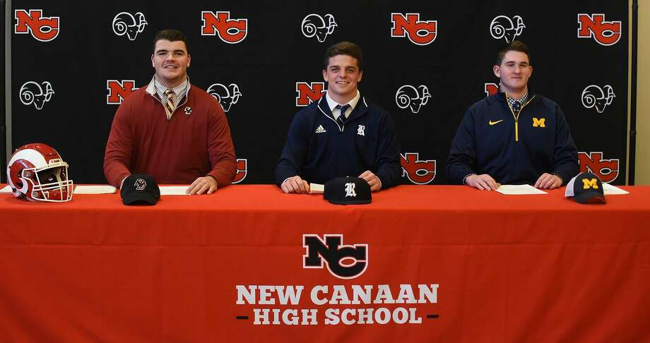 The New Canaan football program has three players sign their National Letters of Intent on Wednesday, Dec. 19, 2018. From left are Jack Conley (Boston College), Garrett Braden (Rice), and Jack Stewart (Michigan). Photo: Dave Stewart / Hearst Connecticut Media / Contributed Photo / Greenwich Time Contributed
