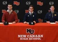 The New Canaan football program has three players sign their National Letters of Intent on Wednesday, Dec. 19, 2018. From left are Jack Conley (Boston College), Garrett Braden (Rice), and Jack Stewart (Michigan).