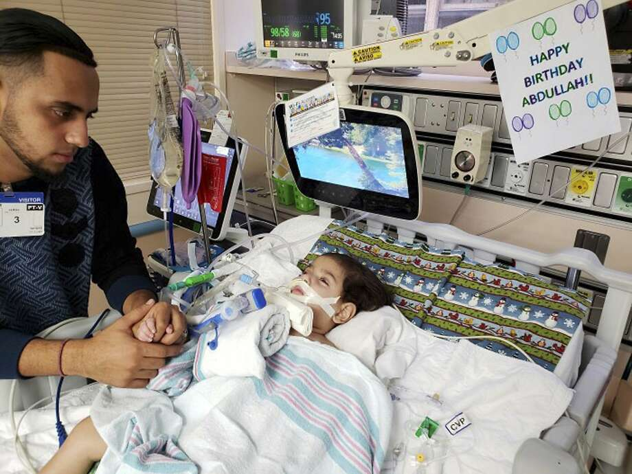 This recent but undated photo, released Monday, Dec. 17, 2018 by the Council on American-Islamic Relations in Sacramento, Calif., shows Ali Hassan with his dying 2-year-old son Abdullah in a Sacramento hospital. The boy's Yemeni mother, blocked by the Trump administration's travel ban, has won her fight for a waiver that would allow her to travel to California to see her son. Basim Elkarra of the Council on American-Islamic Relations in Sacramento said Shaima Swileh was granted a visa Tuesday, Dec. 18, 2018, and will be flying to San Francisco on Wednesday, Dec. 19, 2018. (Council on American-Islamic Relations via AP) Photo: Associated Press