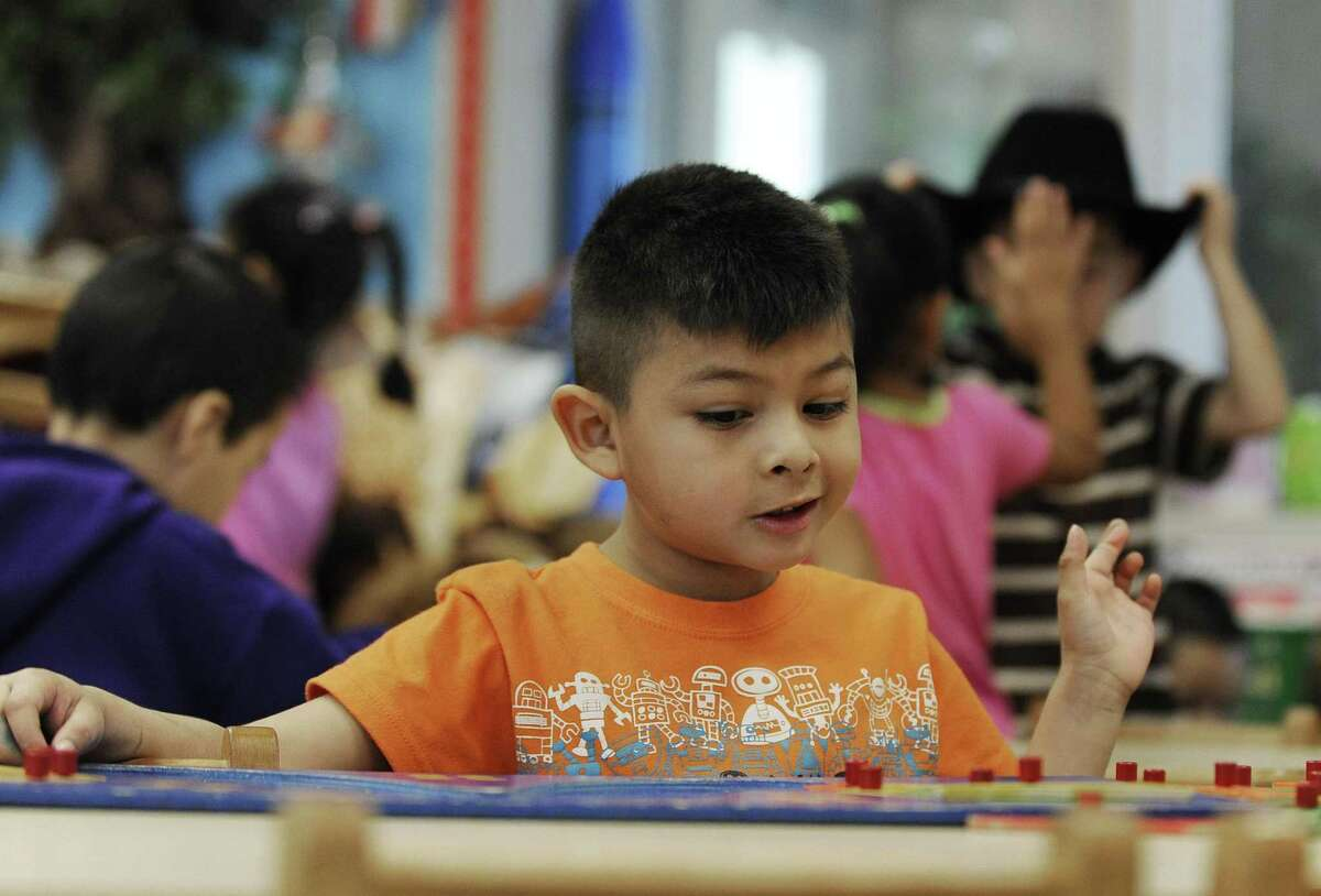 In this Thursday, Feb. 23, 2012 photo, Joseph Simon plays with a puzzle during free time at his pre-kindergarten class at Lion Lane School in Houston. All over Texas, school districts have laid off teachers, support staff and administrators to cope with steep reductions in state education funding. (AP Photo/Pat Sullivan)