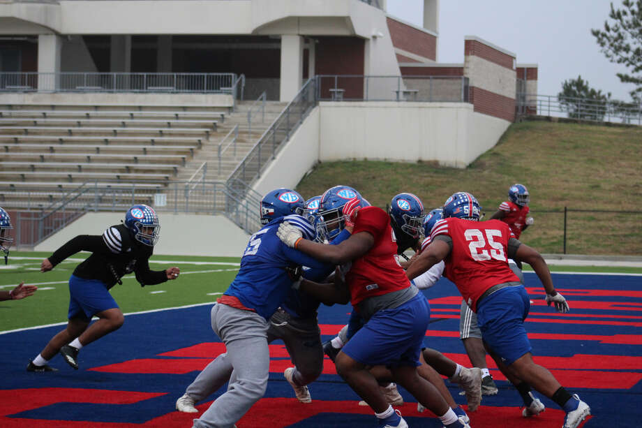 West Brook defensive line going against their offensive line. Photo: Meshach Sullivan