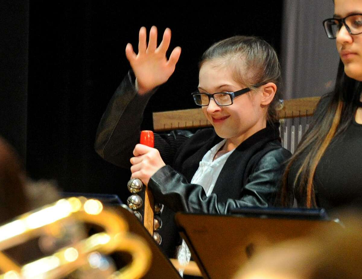 Addison Penna performs in the percussion section during the Betsy Ross Arts Magnet School 2018 Winter Concert in New Haven, Conn., on Wednesday Dec. 19, 2018. The concert featured many popular Christmas carols and were performed between the school's chorus, band, and string ensemble.