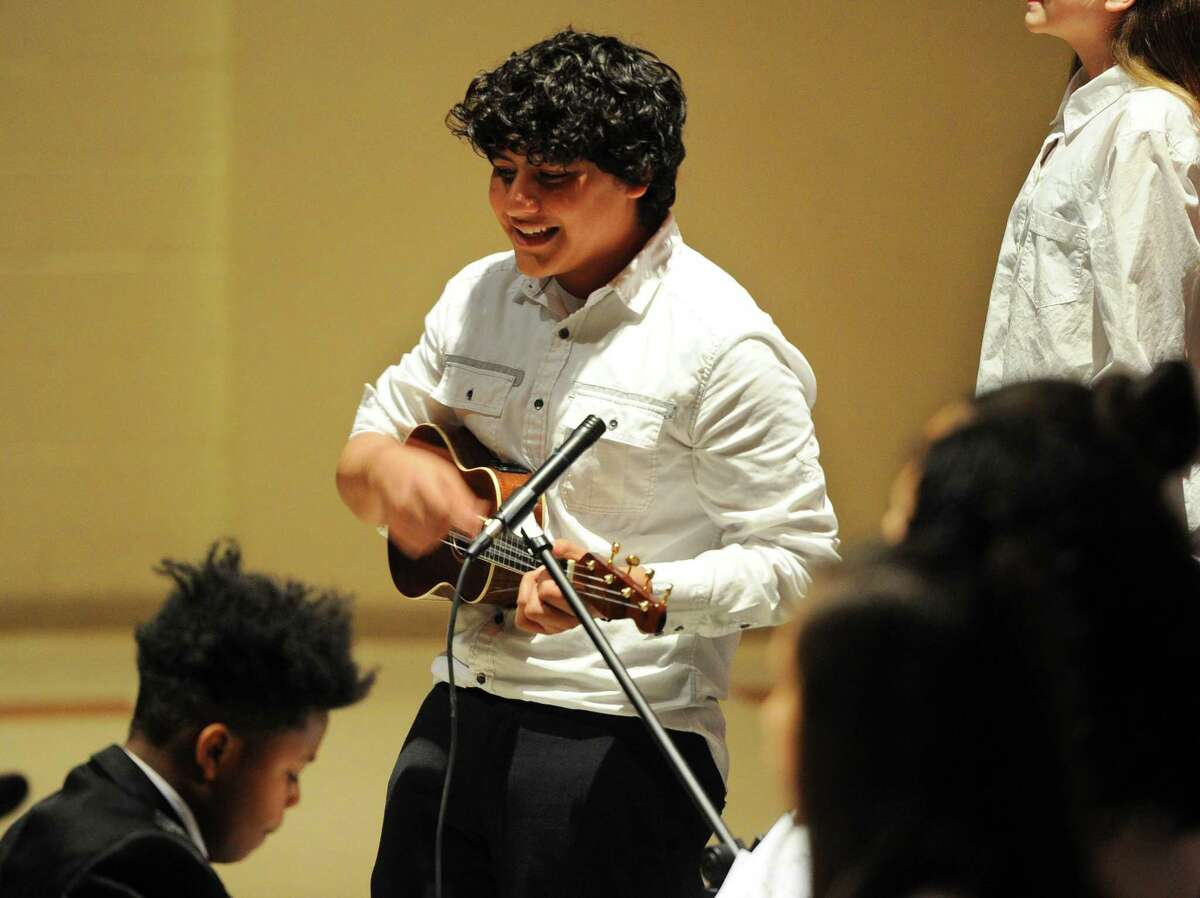 Migeul Loor plays the ukulele for the song Riptide during the Betsy Ross Arts Magnet School 2018 Winter Concert in New Haven, Conn., on Wednesday Dec. 19, 2018. The concert featured many popular Christmas carols and were performed between the school's chorus, band, and string ensemble.