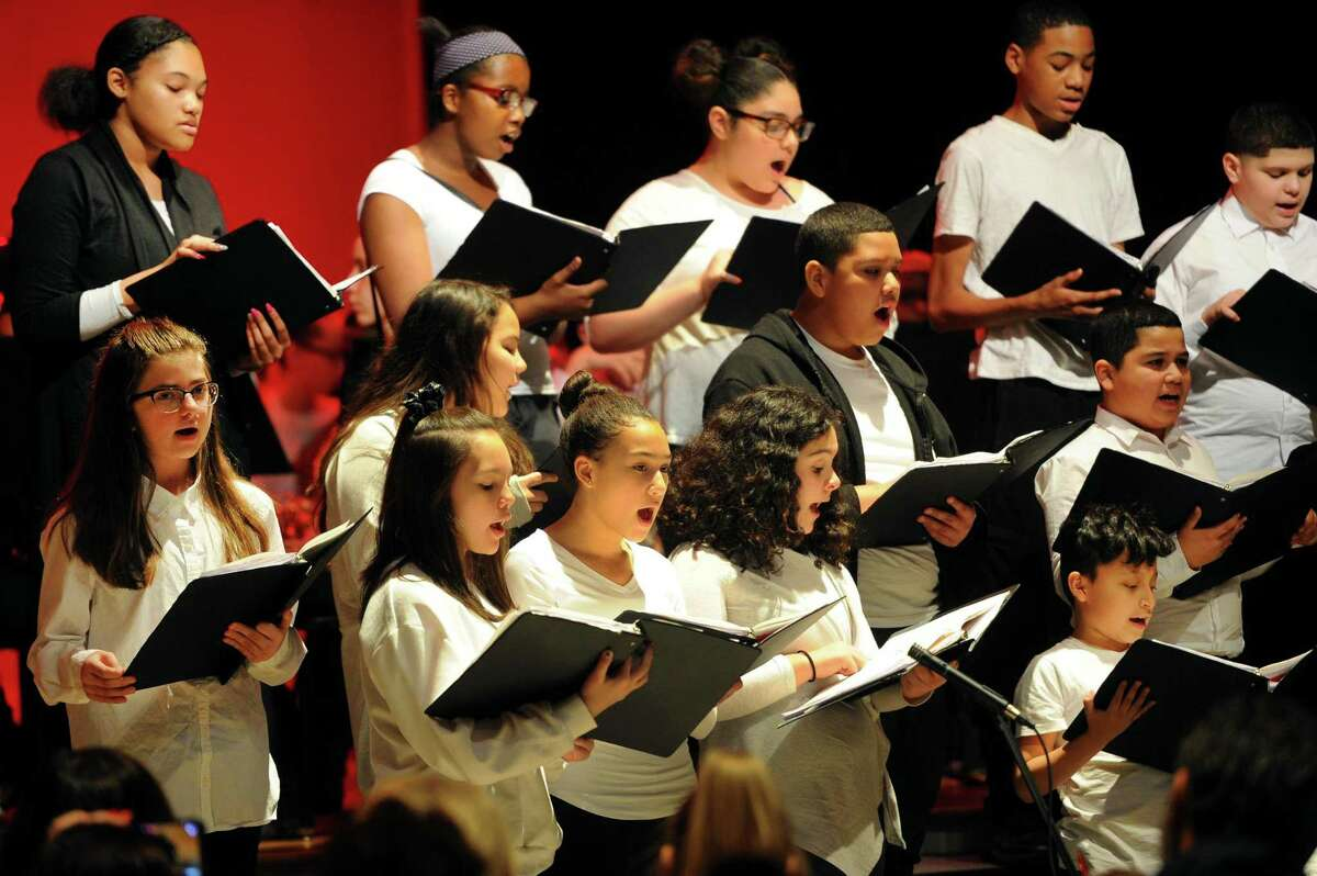 The Betsy Ross Arts Magnet School chorus performs during the 2018 Winter Concert in New Haven, Conn., on Wednesday Dec. 19, 2018. The concert featured many popular Christmas carols and were performed between the school's chorus, band, and string ensemble.