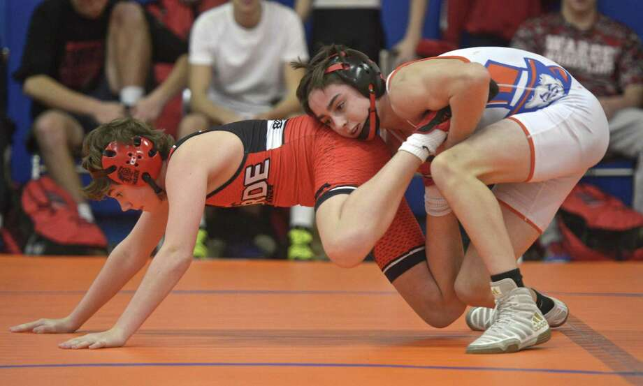 Fairfield-Warde's Connor Breheny (red) and Danbury's Kailan O'Dell (white) wrestle in the 106 pound weight class during the wrestling meet between Fairfield-Warde and Danbury high schools. Wednesday, December 19, 2018, at Danbury High School, in Danbury, Conn. Photo: H John Voorhees III / Hearst Connecticut Media / The News-Times
